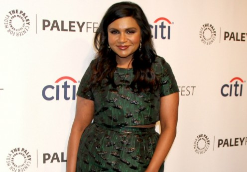 mindy kaling wearing a crop top
